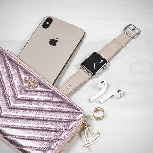 Angel-Whisper-Apple-watch-powder-nappa-band-on-top-close-to-violet-wallet-bs