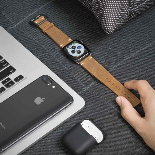 Smoked-Walnut-Apple-watch-brown-leather-vintage-band-on-top-grey-sofa-bs