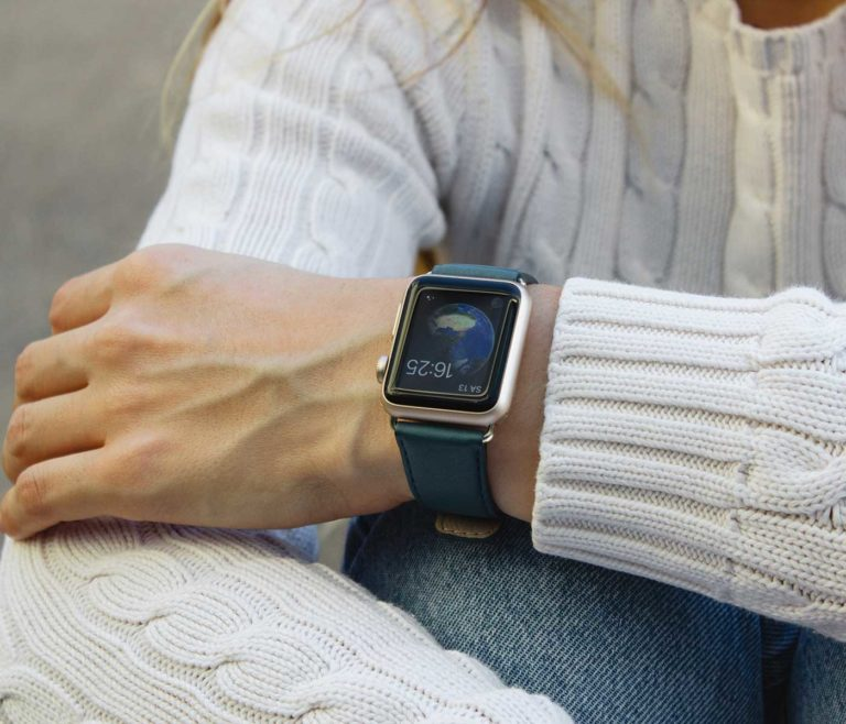 Denim-Apple-watch-nappa-band-on-top-of-a-white-female-pullover