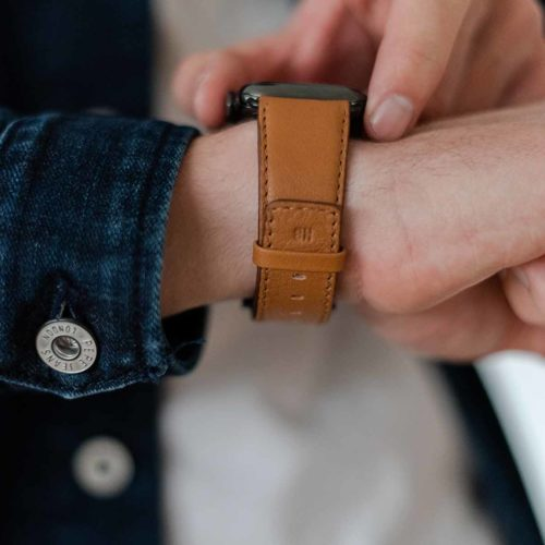 Goldstone-AW-light-brown-nappa-band-with-hot-stamp-monogram-close-to-a-jeans-jacket