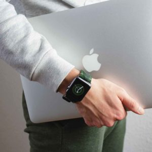 Green-guerilla-suede-band-with-a-silver-macbook-in-the-other-hand