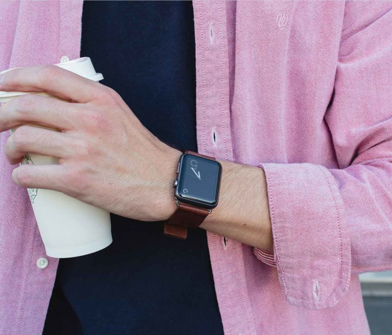 Burnt-Apple-watch-full-grain-dark-brown-leather-band-on-top-of-pink-man-shirt