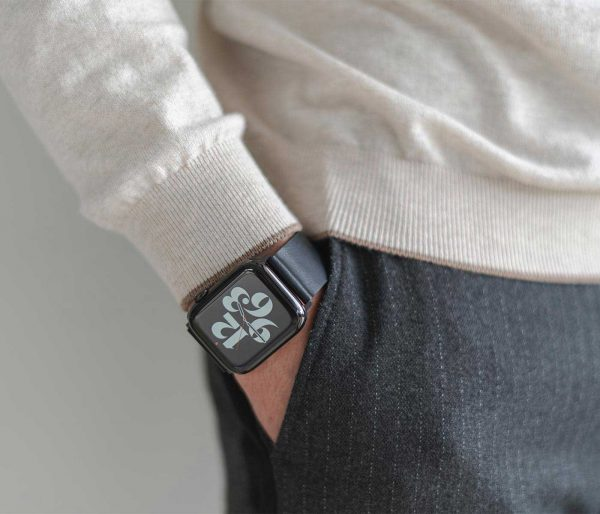 Cassel-Apple-eatch-black-full-grain-leather-band-getting-out-from-a-pocket-of-an-elegant-pant