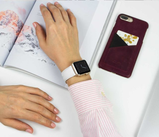 Off-White-Apple-watch-nappa-band-on-wrist-a-woman-reading-an-interior-design-magazine