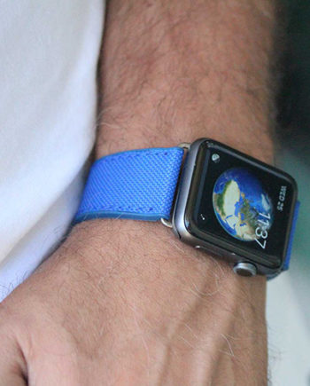 Electric-Blue-Apple-watch-natural-rubber-band-close-to-white-shirt