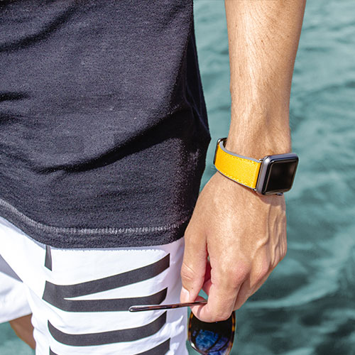 Submarine-Apple-watch-yellow-natural-rubber-band-closeup-with-a-swimwear-ig