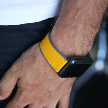 Submarine-Apple-watch-yellow-natural-rubber-band-on-blue-trouser-ig