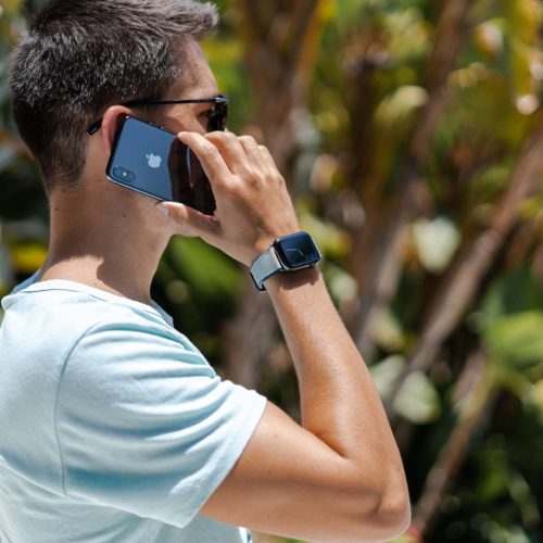 Summer-Cloud-Apple-watch-grey-rubber-band-keeping-a-black-iphone