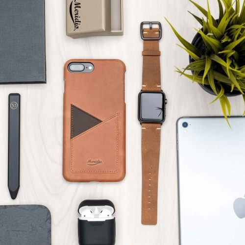 Apple light brown leather accessories on top wood