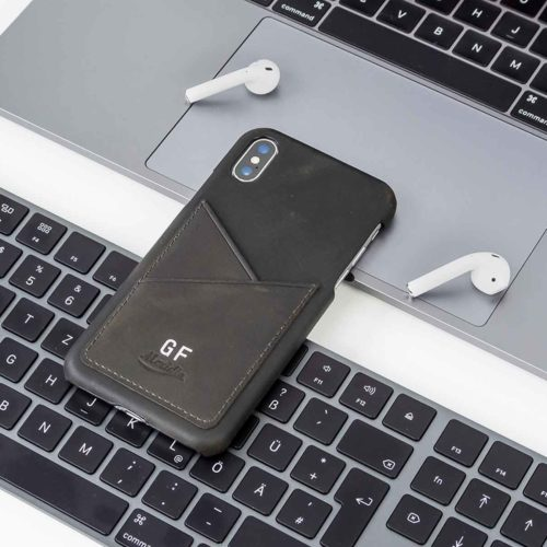 Carbon-Core-iPhone-dark-grey-leather-wallet-case-on-top-of-a-keyboard