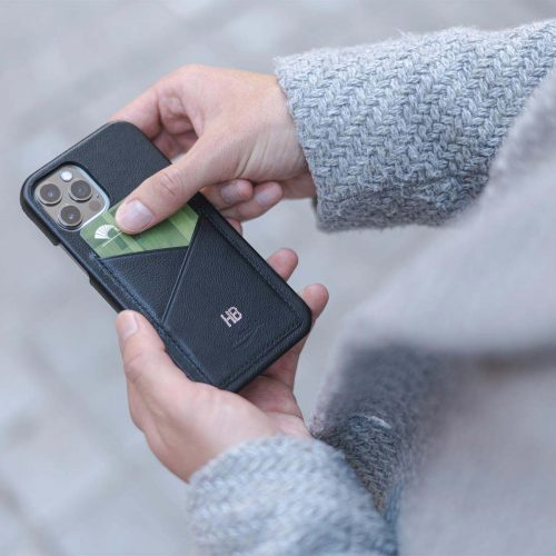 Carbon-Core_iphone-12-pro-leather-case-handling-with-a-grey-coat