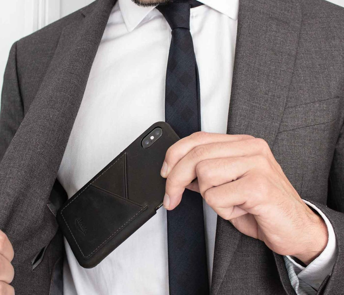 Carbon-core-Iphone-dark-grey-case-inside-a-jacket-pocket-bs
