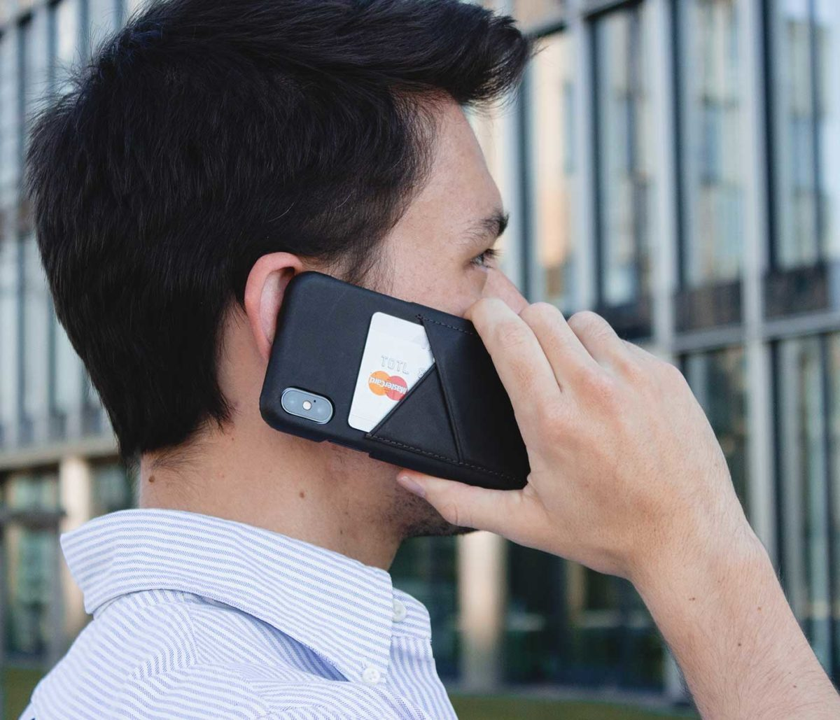 Carbone-Core-Iphone-leather-case-close-to-man-ear-bs