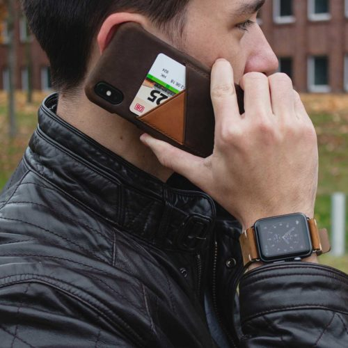 Cigar-dark-brown-iPhone-leather-case-close-to-a-hear-for-him-with-a-black-leather-jacket-outfit