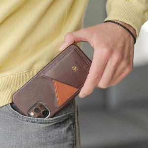 Cigar-iPhone-12-pro-dark-brown-leather-case-kepping-out-from-a-jeans-pocket