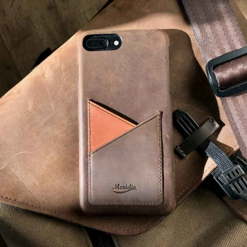 Cigar-old-brown-iPhone-leather-case-on-top-a-travel-backpack