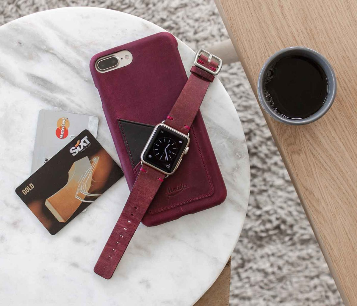 Grapevine-Iphone-leather-case-and-an-Apple-watch-red-band-on-top-bs