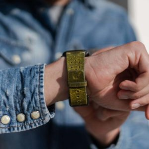 AW-bullet-proof-green-leather-band-with-focus-on-monogram