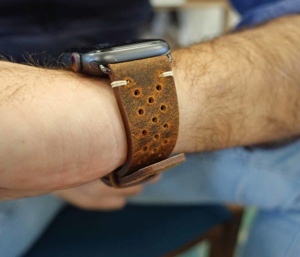 Care-AW-brown-calf-leather-band-with-holes-close-up-on-a-male-wrist