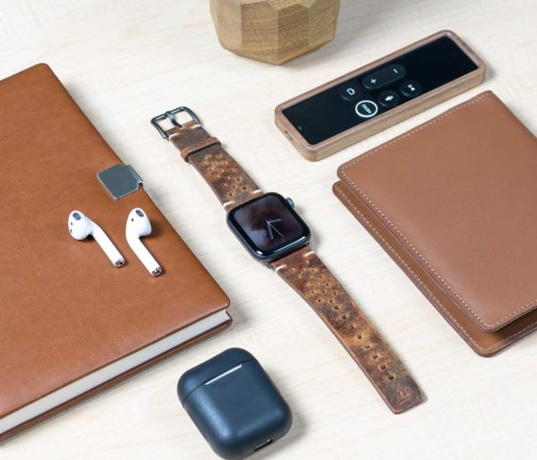 Care-Apple-watch-brown-calf-leather-band-with-30-holes-close-to-a-remote-control