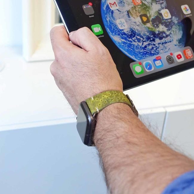 Hope-AW-green-calf-leatehr-band-with-30-holes-with-atablet-on-background