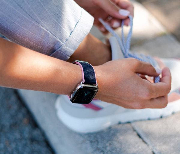 Blue-Abyss-Apple-watch-rubber-band-close-to-a-running-shoes