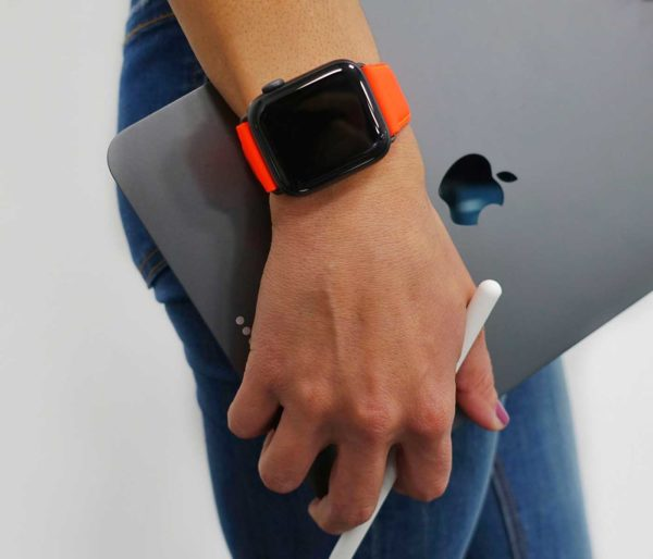 Flaming Mango AW fluo orange nappa band with jeans outfit keeping a silver macbook