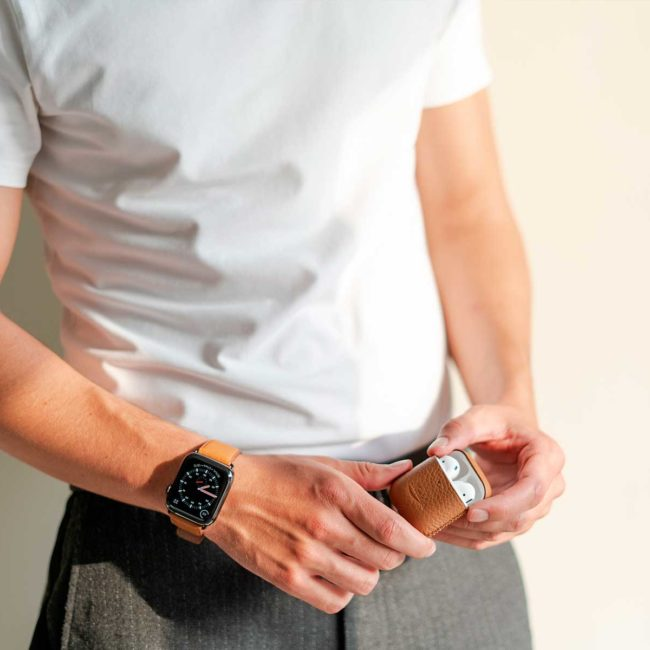 Amber-Airpods-brown-leather-case-for-him-with-an-elegant-outfit-bs
