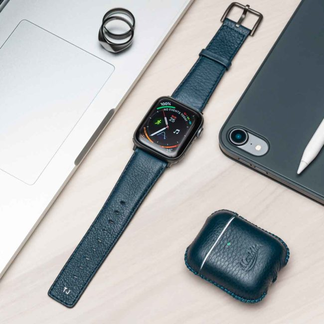 Apple-combo-blue-leather-accessories-with-monogram-on-top-of-a-table