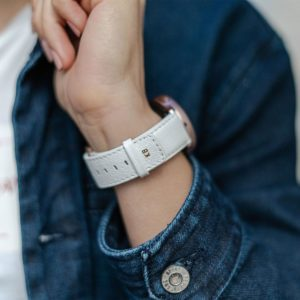 Galaxy-watch-active-white-leather-band-with-focus-on-monogram-with-a-sportwear-outfit-for-her