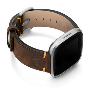 Old-Brown-Fitbit-vintage-leather-band-with-case-on-right
