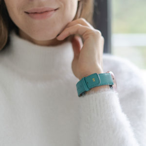 galaxy-watch-active-turquoise-on-wrist-for-her-with-a-white-shirt