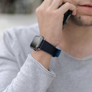 Apple-watch-deep-blue-natural-rubber-band-for-him-close-to-an-iphone