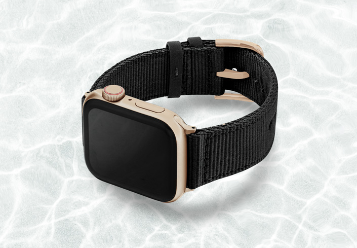 AW-black-tide-recycled-by-ocean-band-44mm-case-on-left-with-aluminium-gold-adaptors