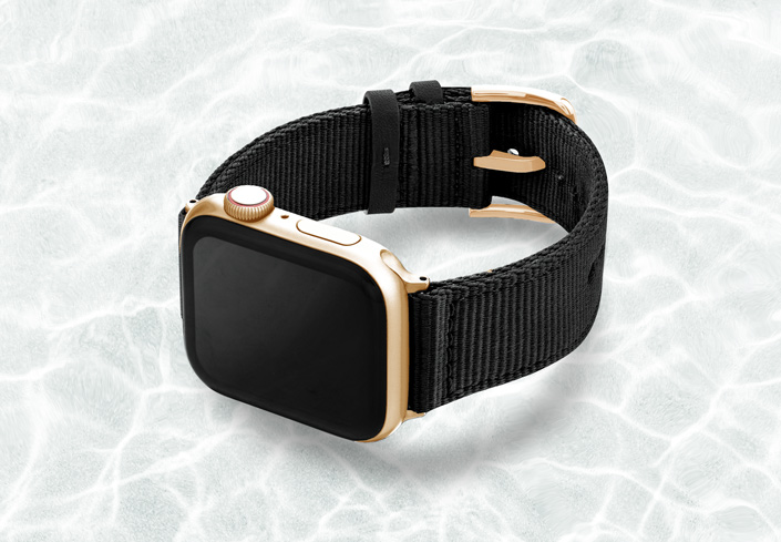 AW-black-tide-recycled-by-ocean-band-44mm-case-on-left-with-stainless-gold-adaptors