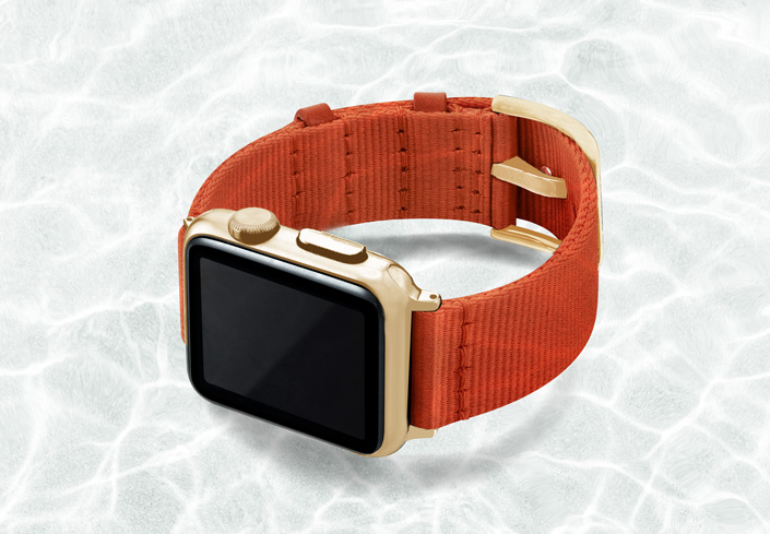 AW-orange-tide-recycled-ocean-plastic-band-40mm-case-on-left-with-stainless-gold-adaptors