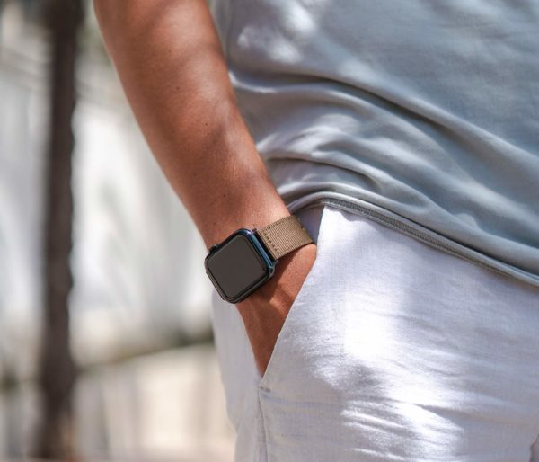 Apple-watch-bronze-tide-band-recycled-ocean-plastic-man-outfit-with-shirt-white-trousers