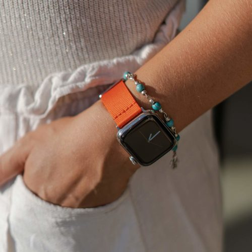 Apple-watch-orange-tide-band-recycled-ocean-plastic-woman-with-hand-in-the-pocket