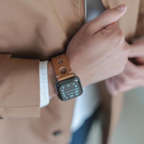 AW light brown full grain leather band for man wearing a coat