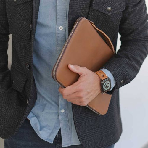 AW light brown full grain leather band for man handling a macbook sleeve