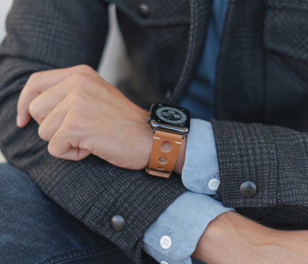 AW light brown full grain leather band for man wearing a jacket