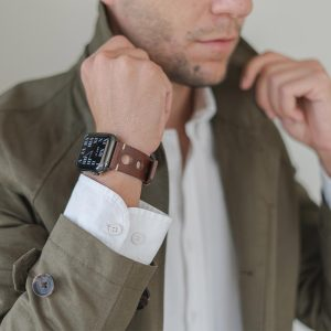 AW dark brown full grain leather band for man wearing a green coat