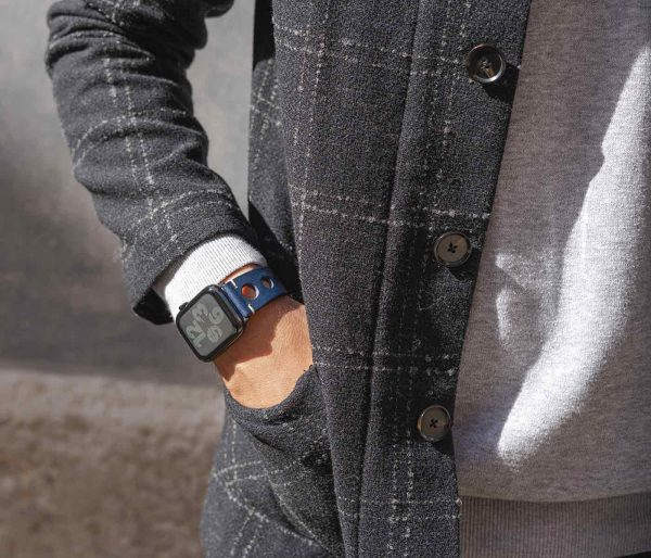 AW blue full grain leather band for man in a sunny day wearing a coat