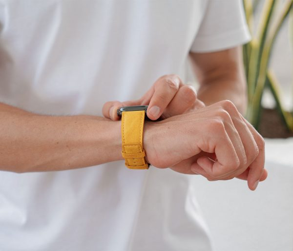 Recycled-Golden-cotton-apple-watch-band-for-him-closeup-lifestyle-mood