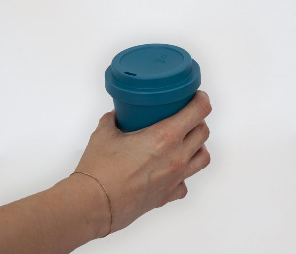 Recycled Ocean bound plastic tide cup on woman hand